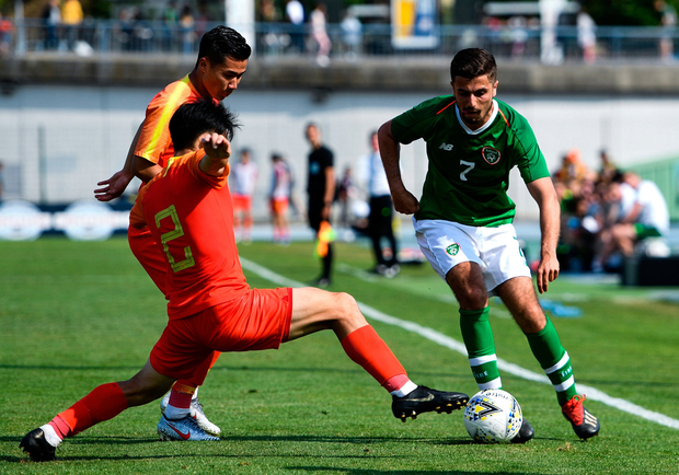 Zach Elbouzedi of Republic of Ireland in action against Lei Tong. Photo: Alexandre Dimou/Sportsfile