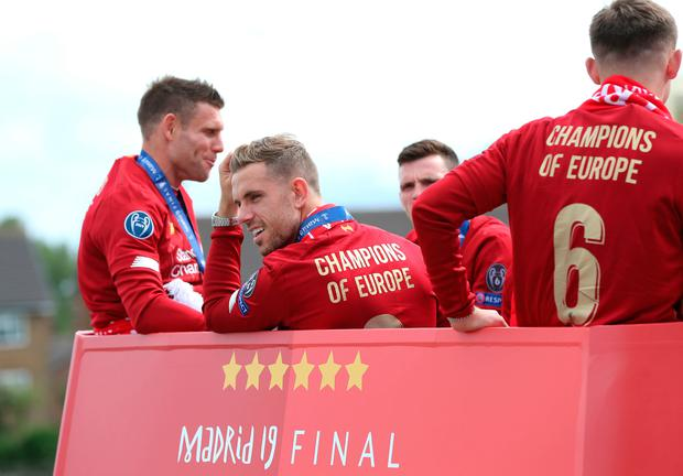 Liverpool's Jordan Henderson (centre) on an open top bus during the Champions League Winners Parade in Liverpool. Barrington Coombs/PA Wire