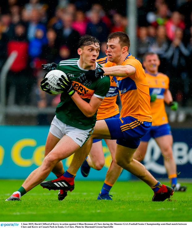 David Clifford of Kerry in action against Cillian Brennan of Clare during the Munster GAA Football Senior Championship semi-final match between Clare and Kerry at Cusack Park in Ennis, Co Clare. Photo by Diarmuid Greene/Sportsfile