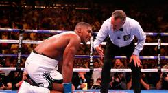 Anthony Joshua (left) spits his gum shield onto the floor as referee Mike Griffin starts a count during the match against Andy Ruiz Je at Madison Square Garden. Photo credit: Nick Potts/PA Wire