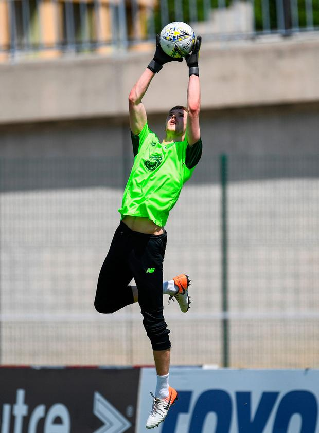 Caoimhin Kelleher warming up with Ireland's U-21s at the Toulon Tournament ahead of Monday's victory over China. Photo: Sportsfile