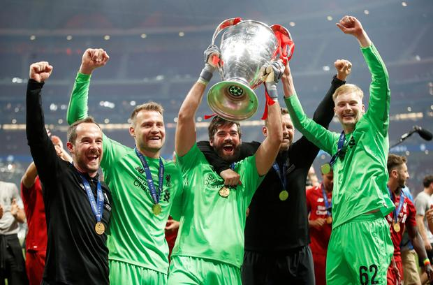 The Cork man (right) celebrating Liverpool's Champions League win with team-mates Simon Mignolet and Alisson on Saturday. Photo: Getty