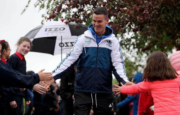 """Ireland rugby star Johnny Sexton visited Caherline National School, Limerick, to deliver a coaching masterclass to students as part of the MACE, """"Going the Extra Smile"""" campaign."""