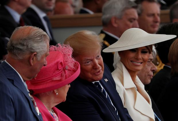 Britain's Charles, Prince of Wales, Britain's Queen Elizabeth, U.S. President Donald Trump and First Lady Melania Trump participate in an event to commemorate the 75th anniversary of D-Day, in Portsmouth, Britain, June 5, 2019. REUTERS/Carlos Barria