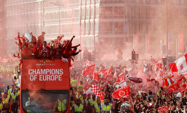 The Liverpool squad parades the European Cup past fans in the city last Sunday