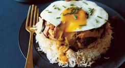 Sunny-side-up egg, chicken and pak choi rice bowl