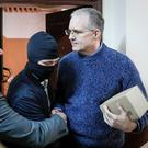Former US marine: Paul Whelan is escorted into a court hearing. Photo: Reuters/Shamil Zhumatov/File Photo