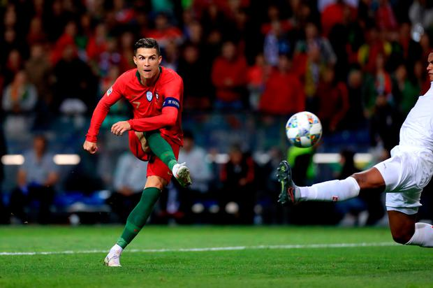 Portugal's Cristiano Ronaldo scores his side's third goal of the game during the Nations League semi-final at the Estadio do Dragao, Porto. Photo: Mike Egerton/PA Wire