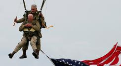 Home the hero: US World War II paratrooper veteran Tom Rice (97), who served with the 101st Airbone, in a parachute jump over the Normandy coast for the 75th D-Day anniversary. Photo: Reuters/Pascal Rossignol