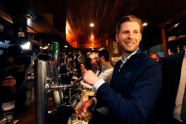 Eric Trump, son of US President Donald Trump, behind the bar in Madigan's pub in the village of Doonbeg, Co Clare, on the first day of US President Donald Trump's visit to the Republic of Ireland. Brian Lawless/PA Wire
