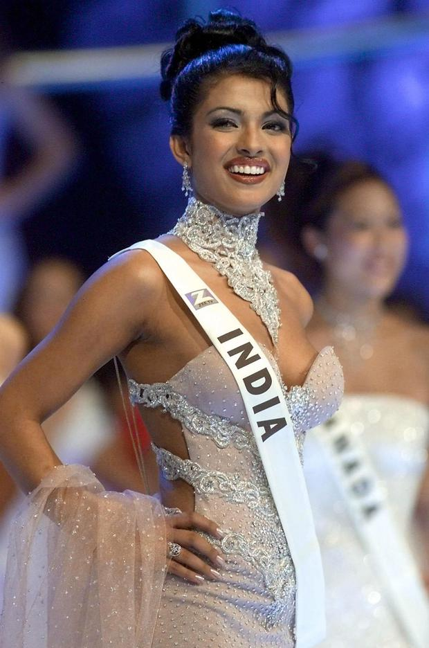 Priyanka Chopra of India poses on stage during the Miss World final at the Millenium Dome in London, 30 November 2000. Chopra won the contest. (Photo credit should read GERRY PENNY/AFP/Getty Images)