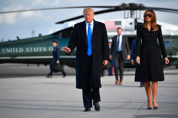 US President Donald Trump and First Lady Melania Trump make their way to board Air Force One at Shannon Airport in Shannon, Ireland, on June 6, 2019 and fly to Normandy, France, to attend the 75th D-Day Anniversary. (Photo by MANDEL NGAN / AFP)