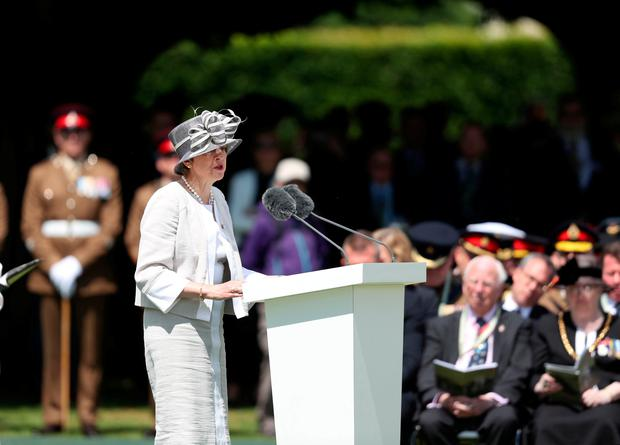 Prime Minister Theresa May speaks at the Royal British Legion's Service of Remembrance, at the Commonwealth War Graves Commission Cemetery, in Bayeux, France, as part of commemorations for the 75th anniversary of the D-Day landings. Steve Parsons/PA Wire