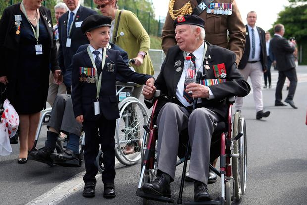 D-Day veteran John Quinn meets George Sayer, 6, in Bayeaux, France on the 75th anniversary of the D-Day landings.