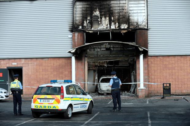 Gardai at the scene of the arson attack on the Flyefit gym in Coolock in 2016