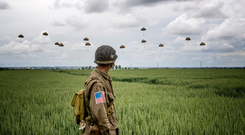 Reflecting: A parachute descent takes place over Sannerville, France, during events to mark the 75th anniversary of the D-Day landings. Photo: Jane Barlow/PA Wire