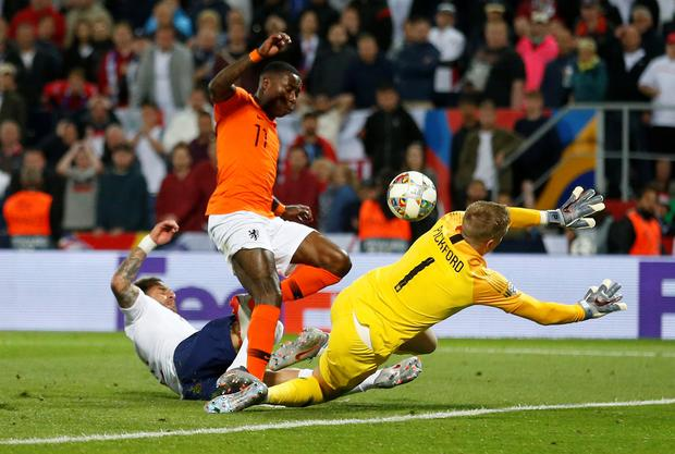 England's Kyle Walker scores an own goal for Holland in their UEFA Nations League semi-final in Guimaraes last night. Photo: Reuters/Carl Recine
