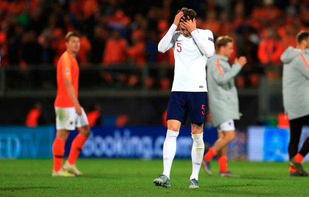England's John Stones appears dejected at the final whistle. Photo: Mike Egerton/PA Wire