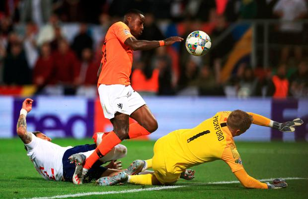 A combination of Quincy Promes and England's Kyle Walker puts the Netherlands in the lead in extra-time. Photo: Mike Egerton/PA Wire