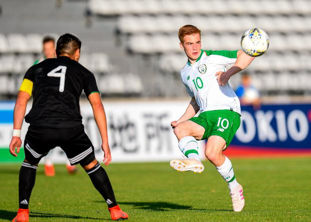 Connor Ronan fires a cross into the box. Photo: Alexandre Dimou/Sportsfile