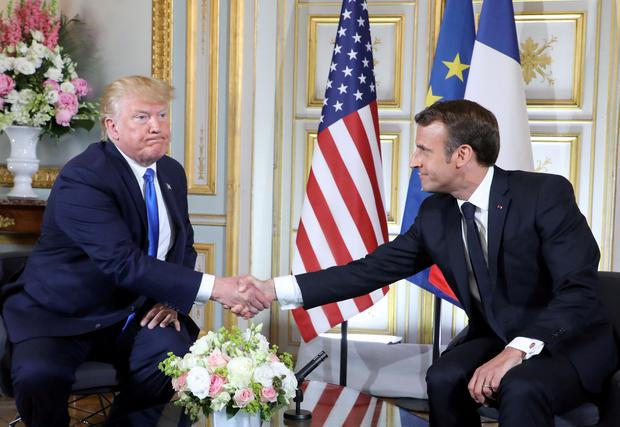 Hand shake: President Donald Trump and French President Emmanuel Macron greet each other during a meeting at the Prefecture of Caen. Photo: Reuters