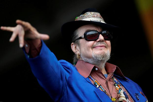 Musician Dr. John gestures to the crowd during the New Orleans Jazz and Heritage Festival in New Orleans, Louisiana April 26, 2013. REUTERS/Jonathan Bachman/File Photo