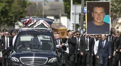 Mourners carry the coffin of murder victim Sean Little (inset)