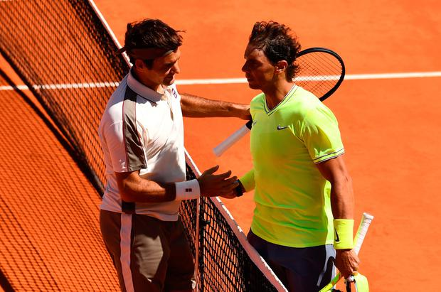 Rafael Nadal of Spain and Roger Federer of Switzerland embrace at the net after their mens singles semi-final match during Day thirteen of the 2019 French Open at Roland Garros on June 07, 2019 in Paris, France. (Photo by Clive Mason/Getty Images)