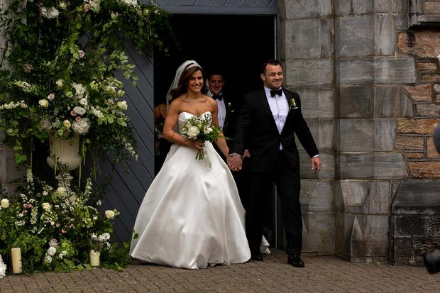 Newlyweds Laura Smith and Cian Healy leave their wedding ceremony. Picture: Andy Newman