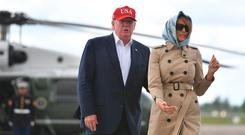 US President Donald Trump and First Lady Melania Trump (R) make their way to board Air Force One at Shannon Airport in County Clare, Ireland on June 7, 2019, for their return trip to Washington DC. (Photo by MANDEL NGAN / AFP)