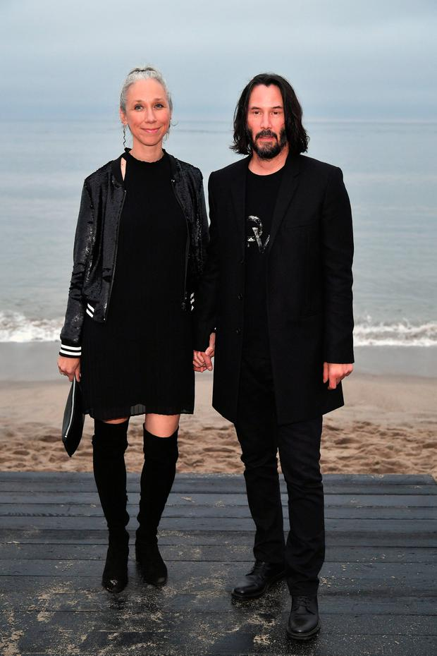 (L-R) Alexandra Grant and Keanu Reeves attends the Saint Laurent Mens Spring Summer 20 Show on June 06, 2019 in Malibu, California. (Photo by Neilson Barnard/Getty Images)