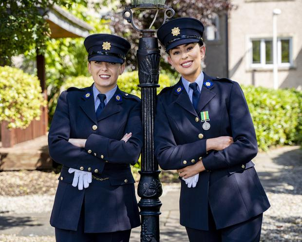 Newly graduated: Anna Toland, from Kilmallock, Co Limerick, and Lisa Sexton, from Mullagh, Co Clare, at a passing out ceremony at the Garda College, Templemore. Photo: Don Moloney/Press 22