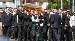 Sean Little's coffin is carried to his funeral Mass in Coolock