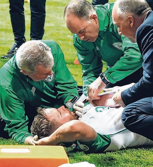 Alan Judge receives attention after breaking his arm. Photo: Lee Smith/Action Images via Reuters