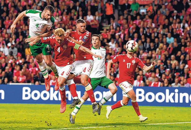 Shane Duffy heads home Ireland's late equaliser against Denmark in Copenhagen last night. Photo: Stephen McCarthy/Sportsfile