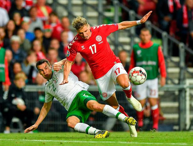 Seamus Coleman of Republic of Ireland in action against Jens Stryger Larsen of Denmark. Photo: Seb Daly/Sportsfile