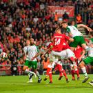 Shane Duffy of Republic of Ireland heads to score his side's first goal against Denmark