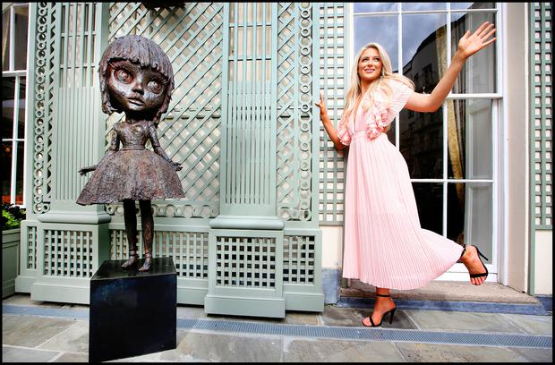 DOe-Eyed: Sophie Cosgrave from Dundrum with artist Patrick O'Reilly's bronze sculpture, 'All The Love That I Have', and inset 'GI Bear', which are on display at the Merrion Hotel as part of the De Vere Irish Art Auction Exhibition. Photos: Steve Humphreys