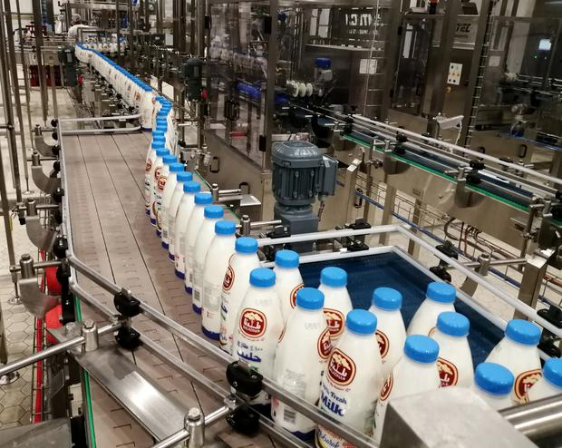 Bottles of milk on the production line at a dairy factory at Baladna farm in the city of Al-Khor, north of Doha, Qatar May 21, 2019. Picture taken May 21, 2019.REUTERS/Naseem Zeitoon