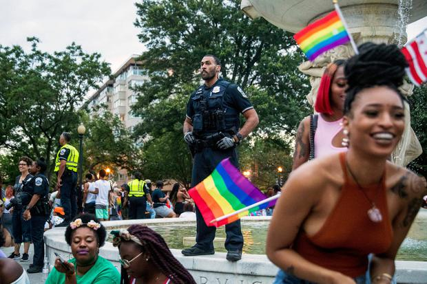 Police keep watch at Dupont Circle at the conclusion of the Capitol Pride Parade in Washington, Saturday, June 8, 2019. (AP Photo/Andrew Harnik)