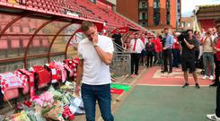 Leyton Orient goalkeeper Dean Brill lays his shirt in the Orient dugout at the Breyer Group Stadium in tribute to former manager Justin Edinburgh. Stephen Jones/PA Video
