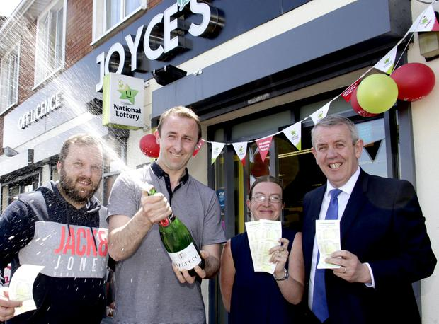 Joyces Supermarket, Doughiska celebrate selling the winning €4 million Euro Lotto Jackpot ticket. Pictured are (l-r) Rafal Dajcz (assistant manager) Sean Clery (manager) CelineCooney and Pat Joyce owner. Pic: Mike Shaughnessy / Mac Innes Photography