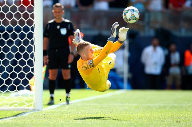 Jordan Pickford of England saves the decisive penalty of Josip Drmic of Switzerland during the shootout in the UEFA Nations League Third Place Playoff match in Guimaraes, Portugal. (Photo by Jan Kruger/Getty Images)