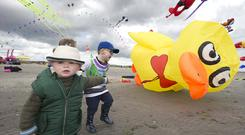 High-flyers: Cathal (20 months), Millie (3), and Adam (4) Tiernan from Bayside in Dublin with a duck balloon at the Dublin Kite Festival at Dollymount Strand. Photo: Damien Eagers/INM