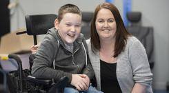 Delight: Cerebral palsy sufferer Max O'Farrell, with his mum Edel, is overjoyed to get into his first-choice school. Photo: Ciara Wilkinson