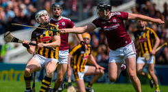 Kilkenny's TJ Reid only has eyes for the ball despite the close attention of Galway's Joseph Cooney. Photo: Sportsfile