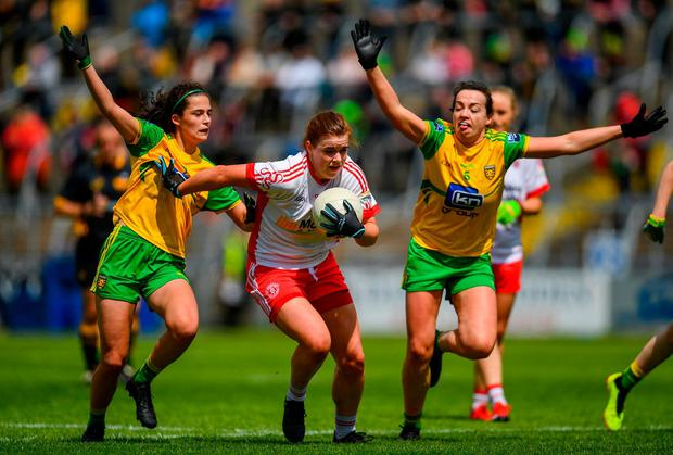 Niamh ONeill of Tyrone in action against Amy Boyle Carr, left, and Nicole McLaughlin of Donegal. Photo: Ramsey Cardy/Sportsfile