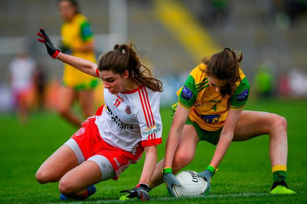Maria Canavan of Tyrone in action against Roisin Rogers of Donegal. Photo: Ramsey Cardy/Sportsfile