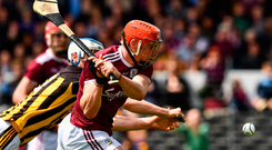 Galway's Conor Whelan fires in a shot under pressure from Kilkenny's Huw Lawlo. Photo: Sportsfile