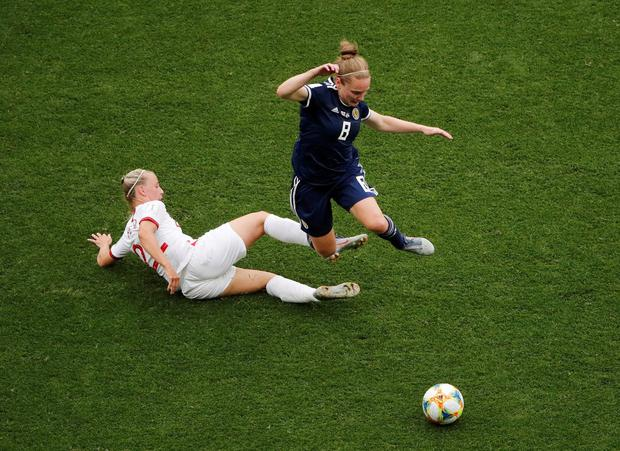 England's Beth Mead in action with Scotland's Kim Little. Photo: Jean-Paul Pelissier/Reuters